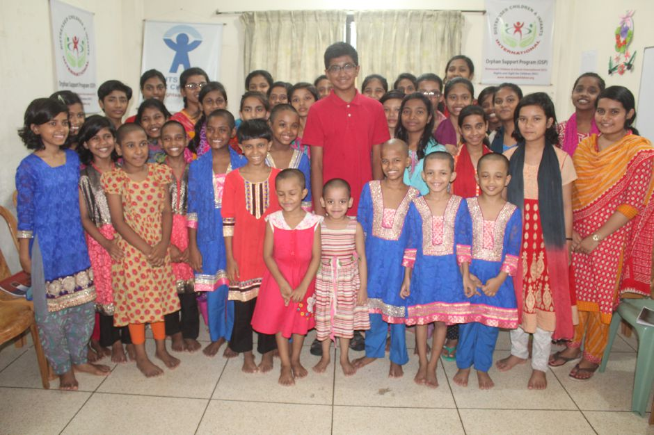 Cheshire Academy sophomore Kavin Kathir, center, spent three weeks abroad, tutoring children in an orphanage in Bangladesh. Kathir is seen standing with many of the children he tutored. He taught those children reading and conversastional English. Kathir's trip was funded by an endowed grant from Cheshire Academy. Photo courtesy of Kavin Kathir.