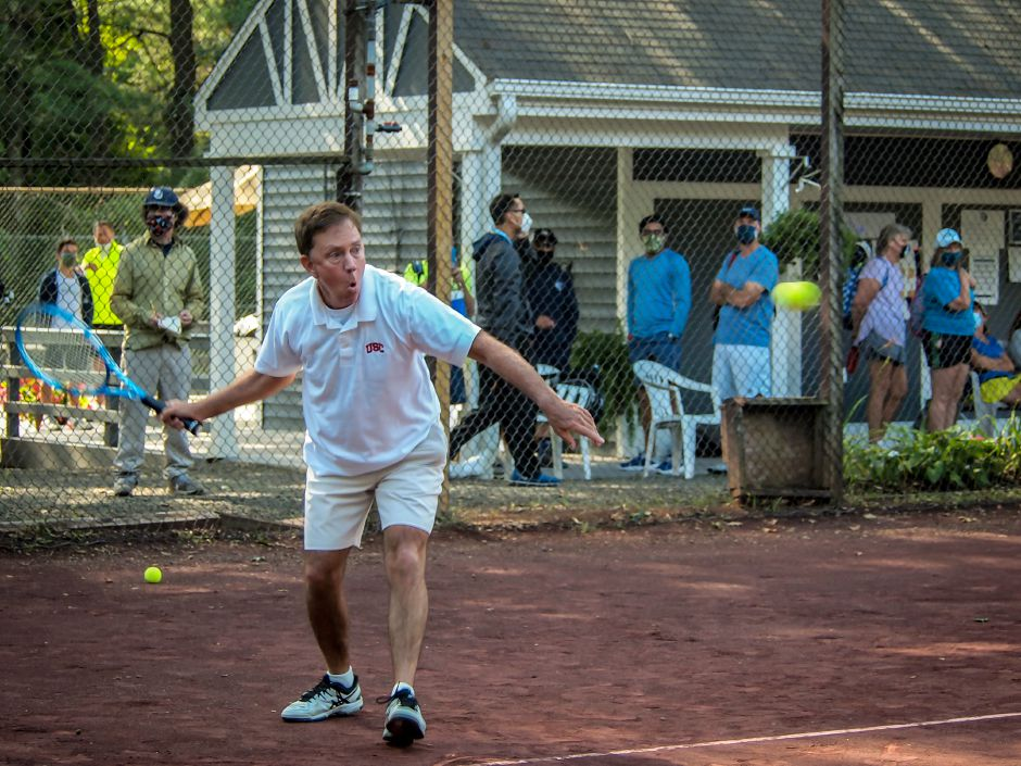 Gov. Ned Lamont focuses on hitting the ball Saturday during the Connecticut State Employees Campaign Tennis Tournament at Copper Valley Club in Cheshire.
