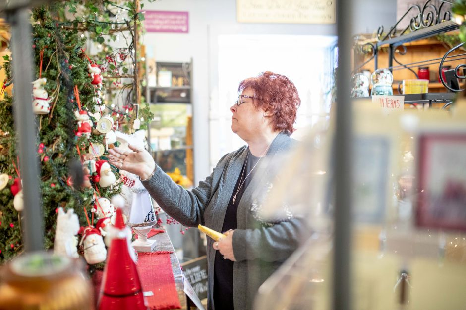 JoAnn Martin browses the wares at The Old Blue Barn in Plainville on Feb. 4, 2020. After 25 years in business, the gift shop will be closing down to allow the owner to retire. | Devin Leith-Yessian/Plainville Citizen