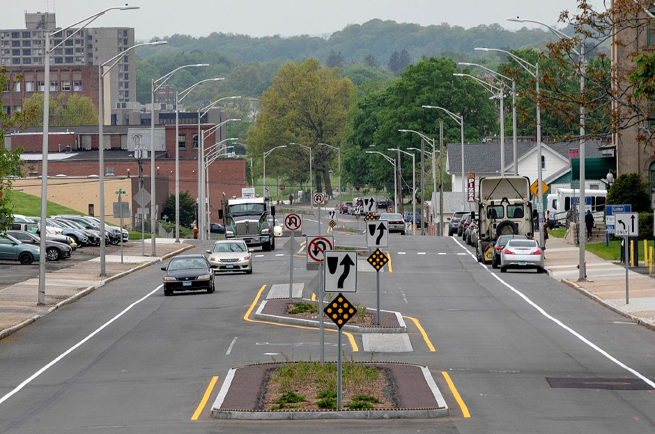Motorists, left, travel east past traffic islands constructed for the Pratt Street Gateway project in downtown Meriden, Fri., May 17, 2019. Dave Zajac, Record-Journal