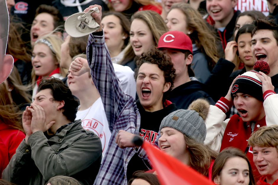 Cheshire fans cheer on the Cheshire High School football team during the 2019 Apple Classic against Southington. Starting Thursday, Cheshire will begin allowing two family members to attend outdoor home games. In Wallingford, up to four family members can attend outdoor events and one can attend indoor activities. Aaron Flaum, Record-Journal