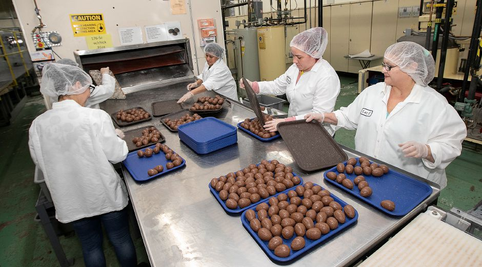 Employees work on a chocolate egg order at Thompson Chocolate, 80 S. Vine St., Meriden, Tues., Feb. 4, 2020. Thompson Chocolate is one of 18 stops on the Connecticut Chocolate Trail. Dave Zajac, Record-Journal