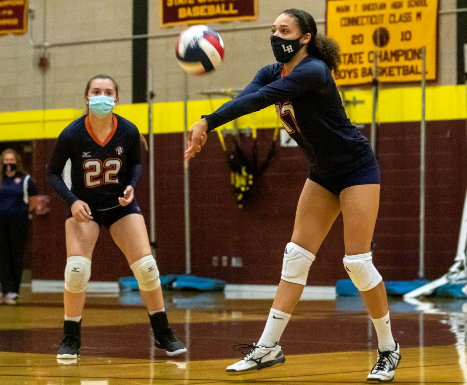 Lyman Hall's Mackenzie Grady bumps the ball against Sheehan at Sheehan High School on Friday, October 2, 2020. Aaron Flaum, Record-Journal
