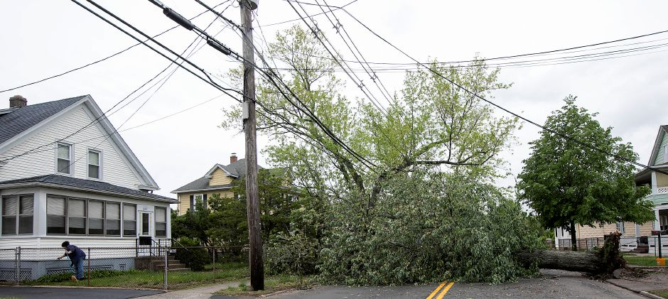A fallen tree blocks the road in front of 236 S. Cherry St. in Wallingford, Wednesday, May 16, 2018. Dave Zajac, Record-Journal