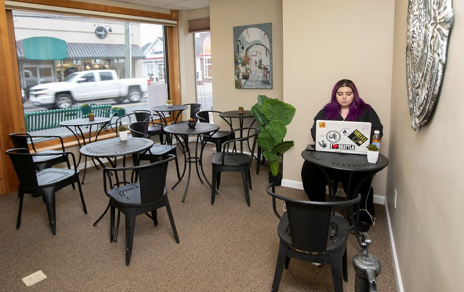 Brianna Fitzpatrick, of Unionville, works on a laptop in a space next to Southington Coffee House that provides additional seating for the business at 51 N. Main St., Wed., Feb. 26, 2020. Dave Zajac, Record-Journal