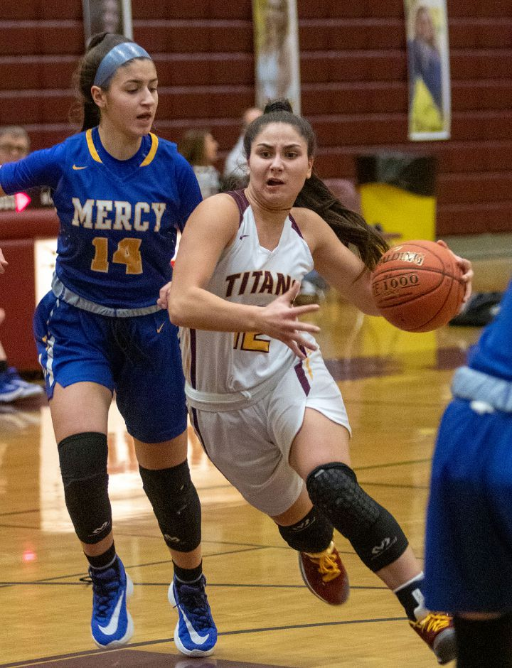 Sheehan's Caitlyn Velez gets by Mercy's Ava Giansiracusa as she drives to the basket during the first half at Sheehan High School on Friday, February 14, 2020. Aaron Flaum, Record-Journal