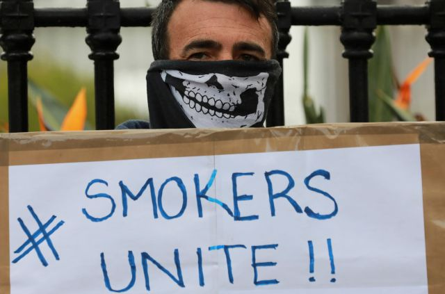FILE — In this June 2, 2020 file photo, a demonstrator holds a placard during a protest against the tobacco ban outside parliament in Cape Town, South Africa. South Africa is three months into a ban on the sale of cigarettes and other tobacco products, an unusual tactic employed by a government to protect the health of its citizens during the coronavirus pandemic. The country is one of just a few around the world to have banned tobacco sales during the pandemic and the only one to still...