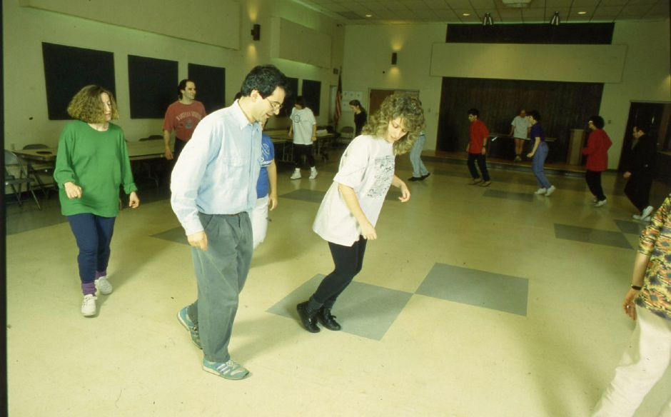 RJ file photo - Debbie Futeran leads students in an Israeli dance class at Temple Beth Sholom in Hamden, Jan. 9, 1994.
