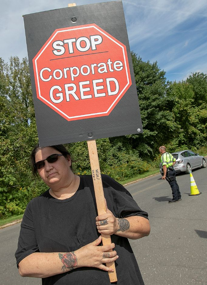 Michelle Basso, of Torrington, a quality control inspector at UTC Aerospace Systems, walks the picket line in front of the business on Knotter Drive in Cheshire, Monday, Sept. 17, 2018. Dave Zajac, Record-Journal