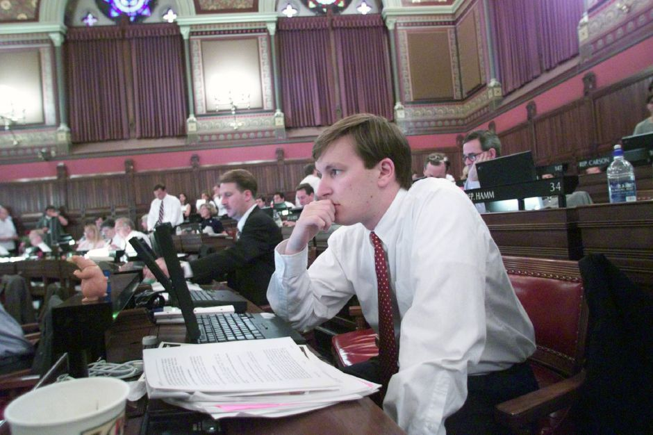 RJ file photo - State Rep. Chris Murphy shows some signs of the long hours he has put in at the state house on the last day of the session June 9, 1999. It has been a big year for him as a freshman legislator and a law student.