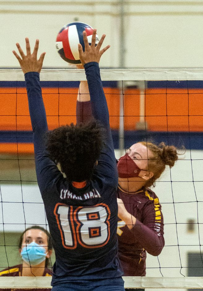 Sheehan's Madison DiPasquale gets the ball past Lyman Hall's Zaiden Piccoli during a match-up at Lyman Hall on Thursday, October 15, 2020. Aaron Flaum, Record-Journal