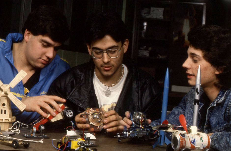 RJ file photo - Rich Panzella, left, Paulo Barros and Kurt Weisheit, right, work with models of vehicles powered by solar power, rocket power and springs from mouse traps, Jan. 1990. All three are in Stephen Trifone