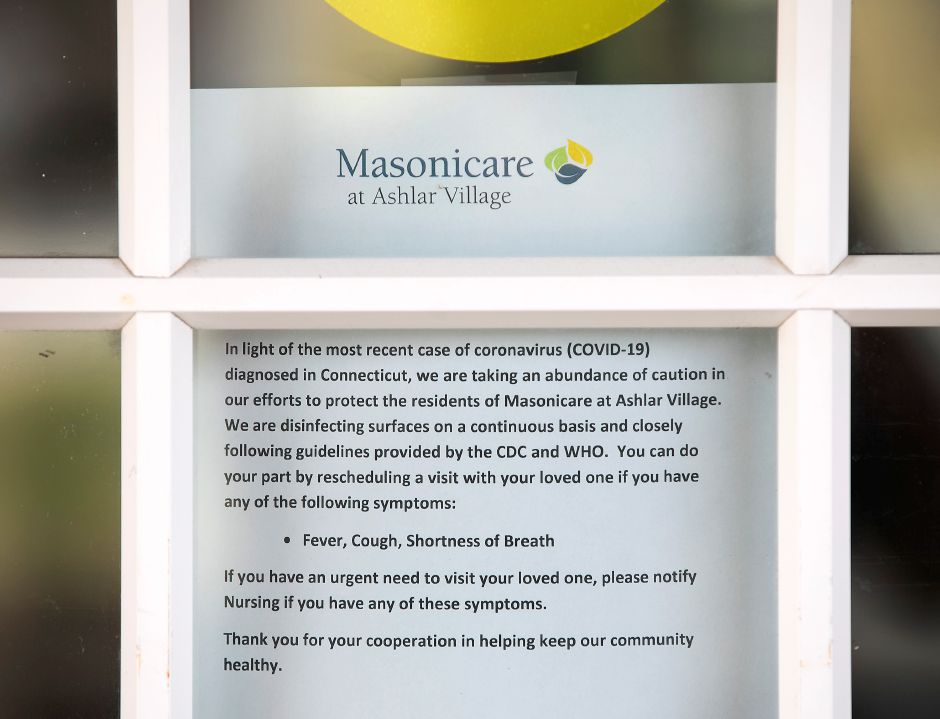 A message to visitors entering Masonicare at Ashlar Village asks them to reschedule visits to loved ones if experiencing fever, cough or shortness of breath, Wed., Mar. 11, 2020. Masonicare began taking additional precautions Saturday after an Ashlar Village resident tested positive for coronavirus. | Dave Zajac, Record-Journal