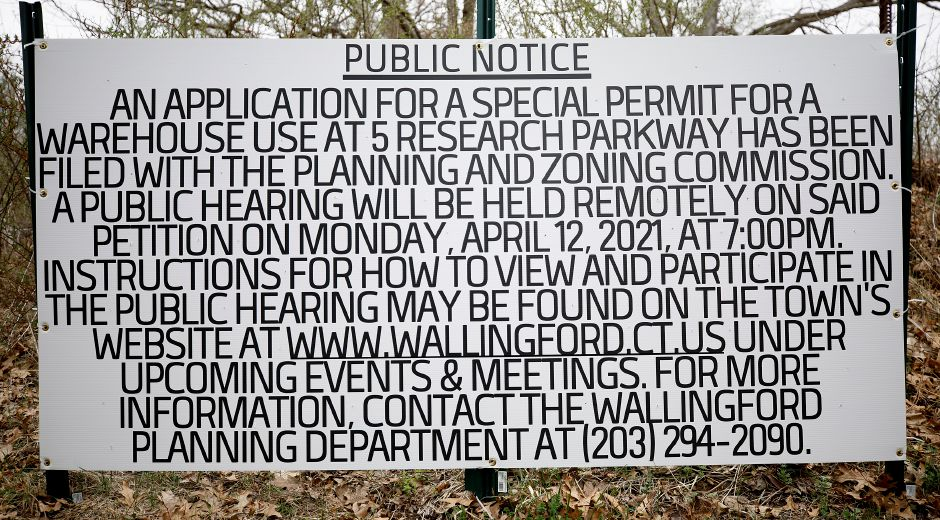 "A ""Public Notice"" sign posted along Barnes Road next to the former Bristol-Myers Squibb property at 5 Research Parkway. in Wallingford, Mon., Apr. 12, 2021. An application for a special permit for a warehouse use at 5 Research Parkway has been filed with the Planning and Zoning Commission. Dave Zajac, Record-Journal"