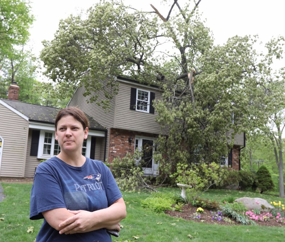 Heather Meyerjack, of 125 Bellamy Road, Cheshire, stands in front of her residence heavily damaged by Tuesday's severe thunderstorm, Wednesday, May 15, 2018. | Dave Zajac, Record-Journal