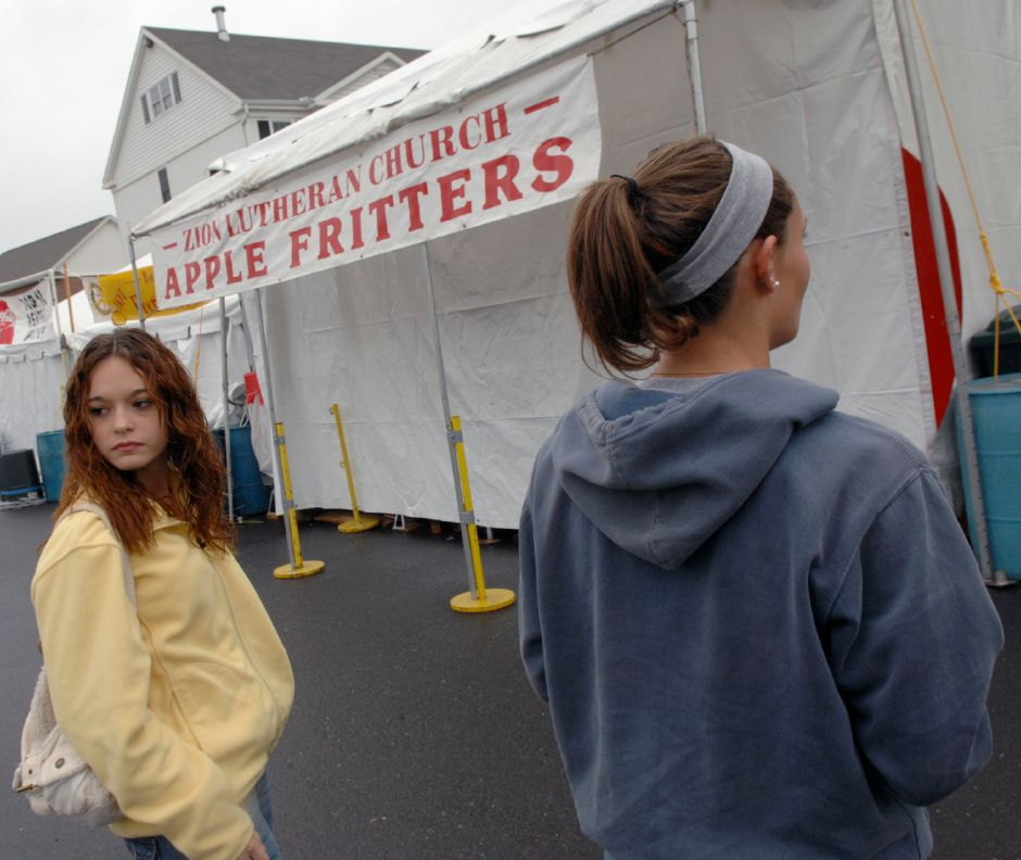 SOUTHINGTON, Connecticut - Friday, September 26, 2008 - Kristi Wood, left, and Molly Welch, both 17 year old seniors at Southington High School, waited patiently, as did many others, for the Zion Lutheran Church Apple Fritter booth to open at 5:00 p.m. on Friday, which it didn