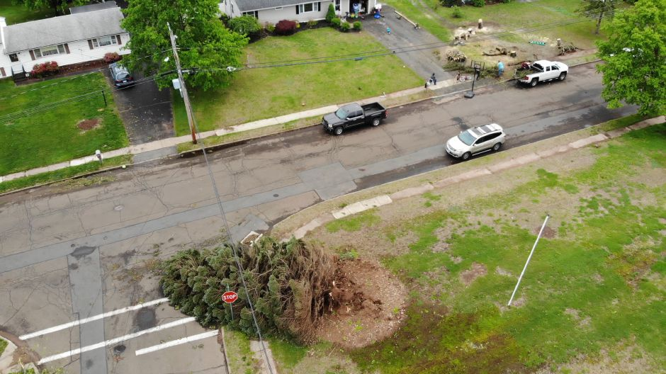 Groups clear debris from their yard on Brian Road near the intersection with Brich Drive in Wallingford May 17, 2018. | Richie Rathsack, Record-Journal