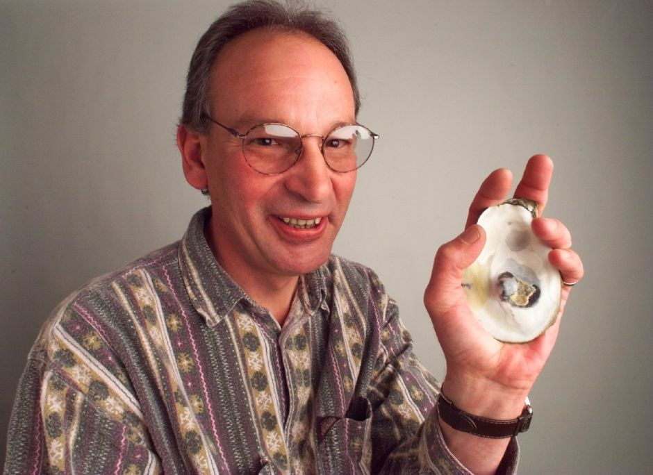 RJ file photo - Ben Bryda, of Meriden, found this huge black pearl in an oyster that cost him 65 cents, March 1999.