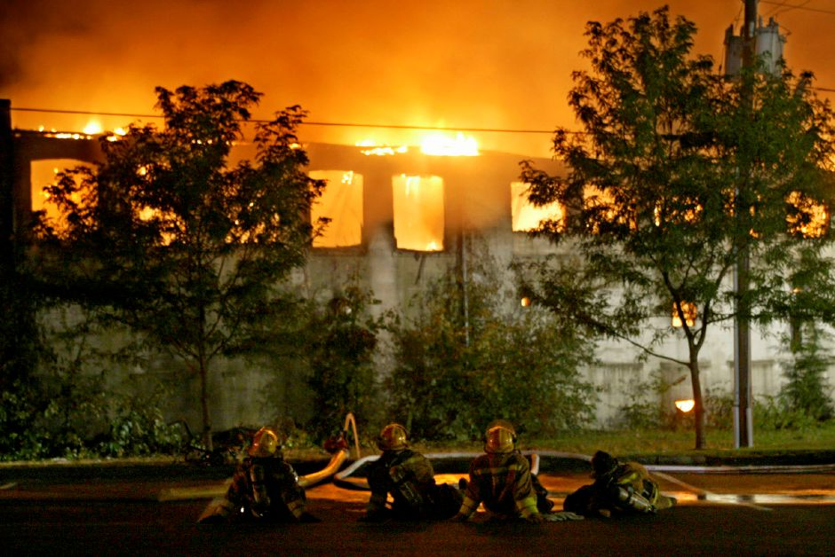 Southington firefighters rest on a break from battling a blaze at the Beaton and Corbin Co. in Southington, CT, Monday evening September 22, 2003. (AP Photo/Record Journal, Dave Zajac)