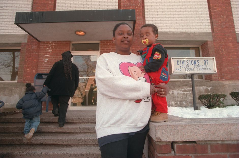 RJ file photo -Sujey Pizarro of Meriden with her 1-year-old son Anthony. Pizzaro participates in teh WIC program and says it is very helpful for her baby, March 1999.