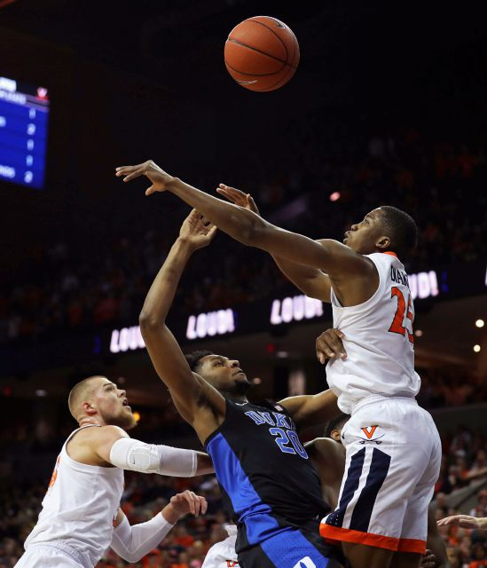 Virginia forward Mamadi Diakite (25) blocks a shot from Duke center Marques Bolden (20) during the first half of an NCAA college basketball game Saturday, Feb. 9, 2018, in Charlottesville, Va. (AP Photo/Zack Wajsgras)