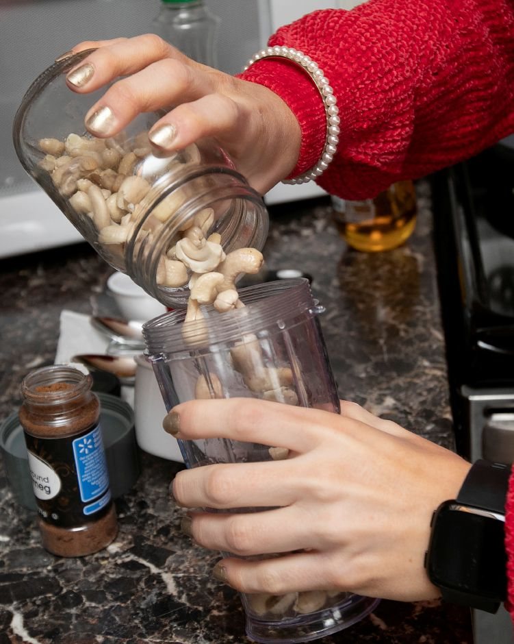 Wallingford native Kristen Dearborn adds cashews while making healthy egg and dairy-free eggnog, Mon., Dec. 17, 2018. Dave Zajac, Record-Journal