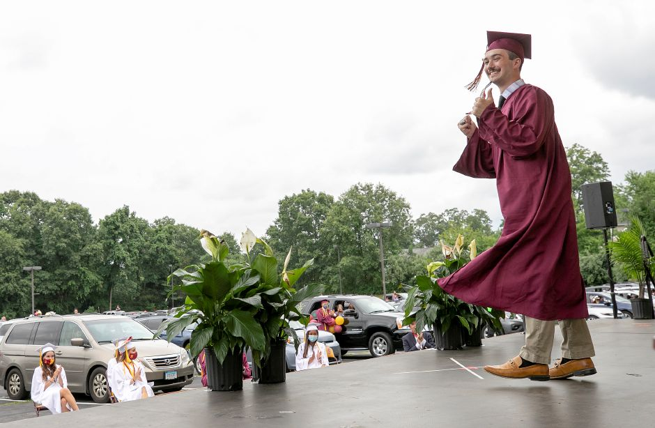 Graduate Andrew Mansfield gives a thumbs up as his name is called to receive his diploma during graduation ceremonies at the Toyota Oakdale Theatre in Wallingford, Mon., Jul. 6, 2020. Dave Zajac, Record-Journal