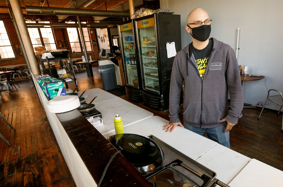 Josh Norris, co-owner of Witchdoctor Brewing Company, talks about the current kitchen at the 168 Center St. business in Southington business Tues., Apr. 13, 2021. Witchdoctor Brewing Company is planning an expansion. Dave Zajac, Record-Journal
