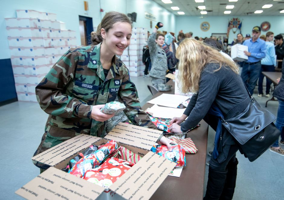 Isabella Gregor puts gifts into a care package during Hero Boxes annual packing day on Nov. 9, 2019 at the New Britain Veterans of Foreign Wars. The non-profit sends hundreds of care packages to soldiers serving in war zones each year. | Devin Leith-Yessian/Berlin Citizen