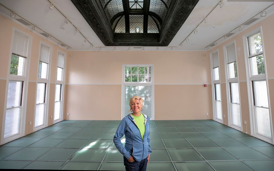 Kathy Matula, recreation coordinator, stands in the main room of the Augusta Curtis Cultural Center on East Main Street in Meriden, Tues., Sept. 22, 2020. The city's Parks & Recreation Department is booking and operating events at the Augusta Curtis Cultural Center, after the center's board of directors dissolved earlier this summer. Dave Zajac, Record-Journal