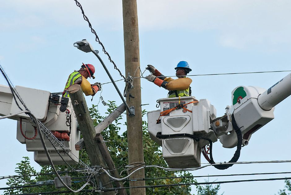 FILE: Al Valerio/Cheshire Herald - Eversource crews were busy repairing wires on a poll along Cornwall Avenue on Friday, Aug. 7, as the utility company and Public Works Department struggled to restore power to thousands in town who lost electricity during Tropical Storm Isaias.