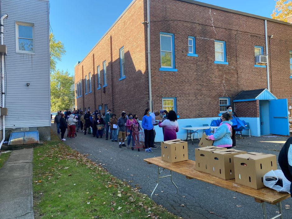 Meriden residents line up at the Joy Unlimited Ministries International church for the Farmers to Families Boxed Food Program on Saturday afternoon.