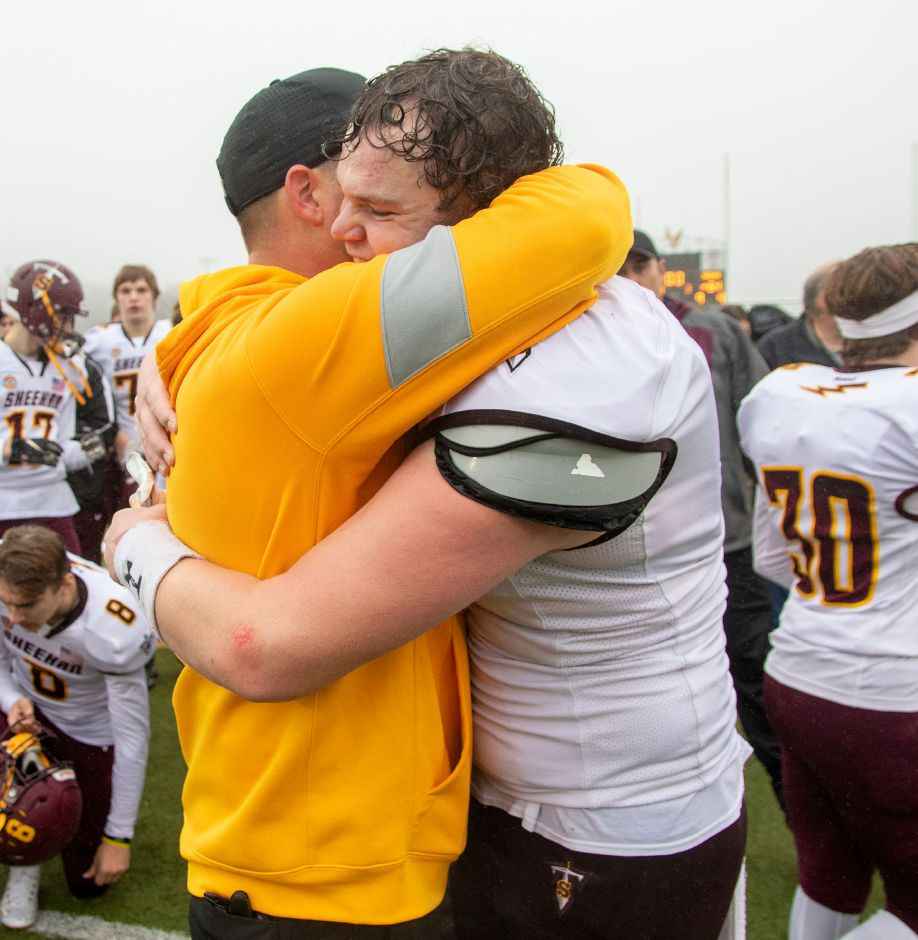 Sheehan's coach John Ferrazzi celebrates with Braedon McCarthy after beating Bloomfield High School at Trumbull High School during the CIAC Class S Championship Football game. Aaron Flaum, Record-Journal