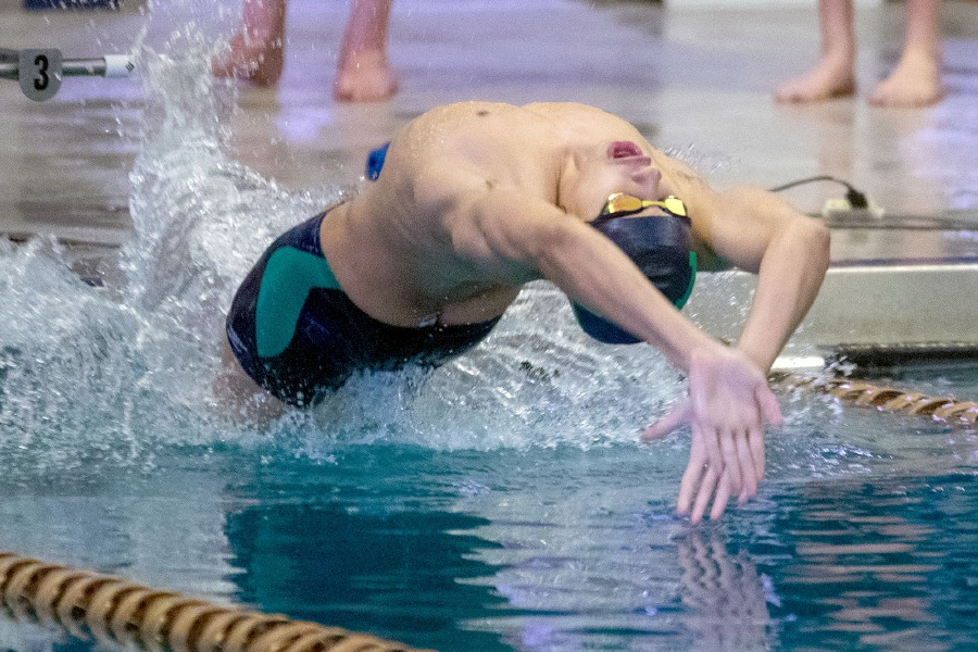 Meriden Co-Op's Mehdi Moumen starts the backstroke leg during the 200 Medely Relay against Southington at Platt High School on Wednesday, Feb. 24, 2021. Aaron Flaum, Record-Journal