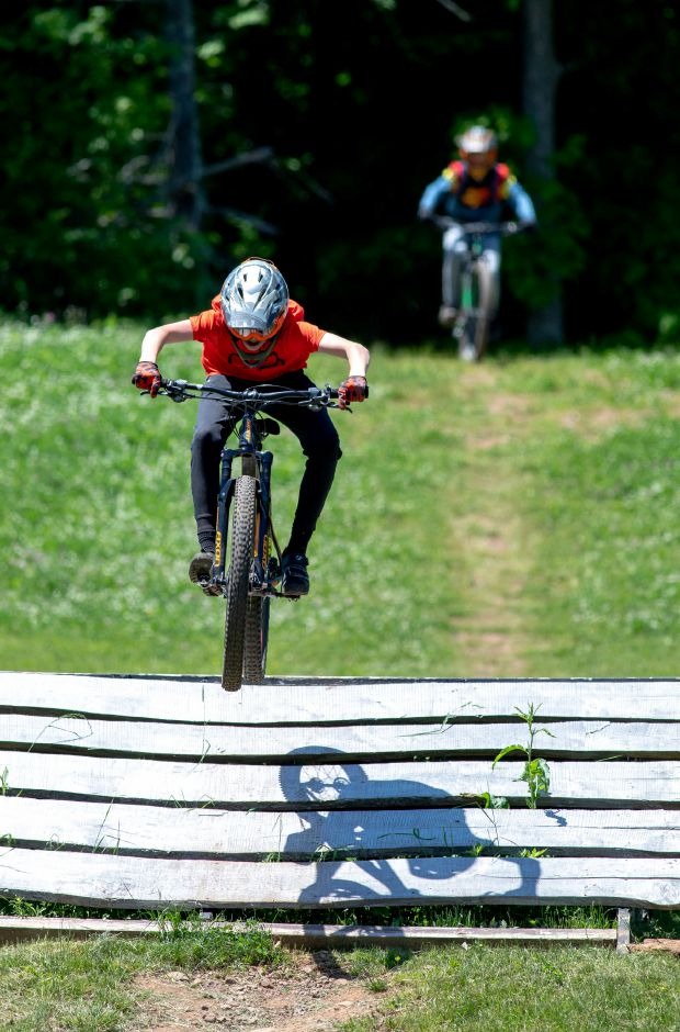 Mountain bikers take advantage of perfect conditions at Powder Ridge in Middlefield on May 31, 2020. The park resumed allowing biking, disc golf and outdoor dining on May 21 as the state began lifting quarantine restrictions on businesses. | Devin Leith-Yessian/Record-Journal