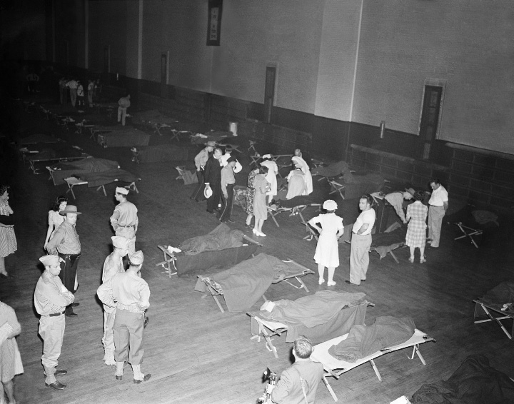 This is the scene at the armory, where bodies were brought in the aftermath of the circus fire at Hartford, Connecticut, July 6, 1944. (AP Photo/Murray Becker)