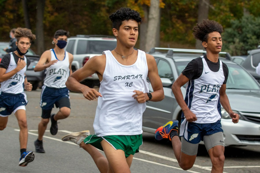 Maloney's Reynaldo Torres left and Platt's Anthony Nimani set the early pace at the start of the Meriden cross country meet at Hubbard Park on Wednesday. Torres went on to win in 17:19. Photos by Aaron Flaum, Record-Journal