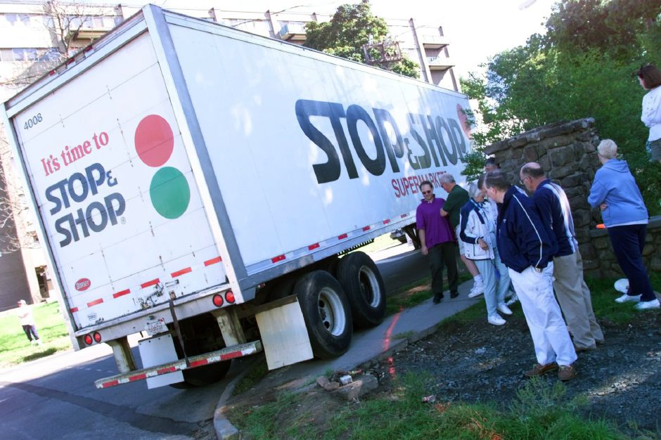The Stop & Shop truck rides over the curb during one of several passes around the corner of Parker and East main during the truck and tree maneuvering test on Sunday Sept. 26, 1999.