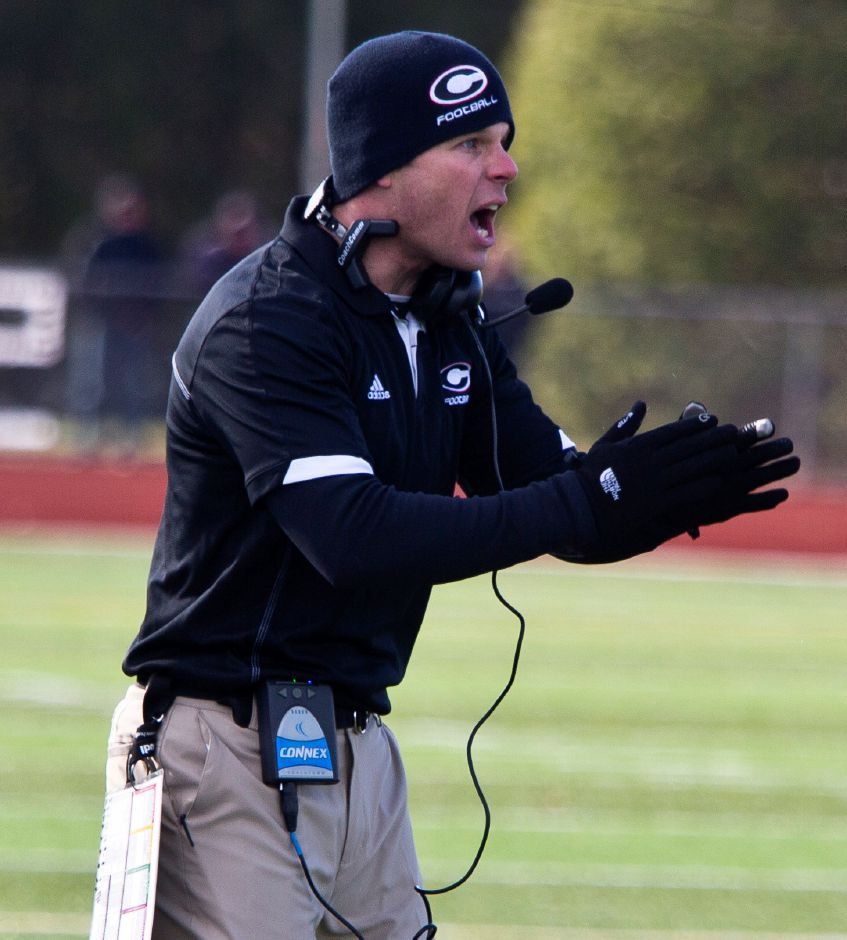 In this 2013 file photo, Cheshire head coach Don Drust cheers on the Rams during the first half at the Apple Classic football game at Cheshire High School on Thanksgiving Day that year. Drust's future with the team is uncertain.