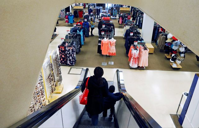 FILE - In this March 22, 2017, file photo, a woman and child ride the escalator at a Sears store in St. Paul, Minn.  Sears has filed for Chapter 11 bankruptcy protection Monday, Oct. 15, 2018, buckling under its massive debt load and staggering losses. The company once dominated the American landscape, but whether a smaller Sears can be viable remains in question. (AP Photo/Jim Mone, File)