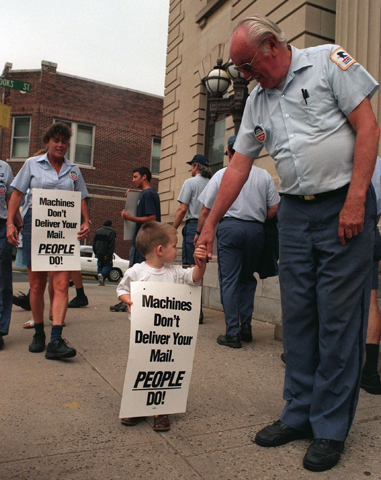 Tom Barry, and his grandson, Justin Onofrio, picket outside of the Meriden post office on Colony Street June 9, 1999.