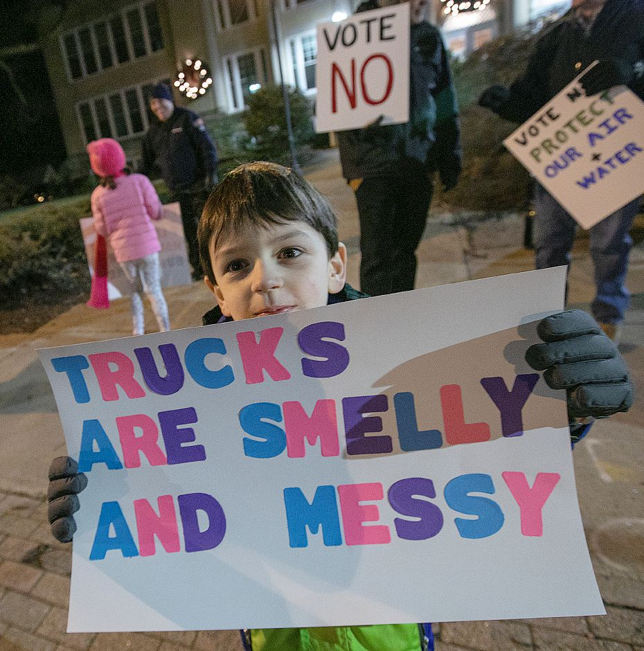 "Tommy Prentice, 6, of Wallingford holds a sign ""Trucks Are Smelly And Messy"" while protesting development of the former Bristol-Myers Squibb property with family at Wallingford Town Hall, Mon. Jan. 14, 2019. Dave Zajac, Record-Journal"
