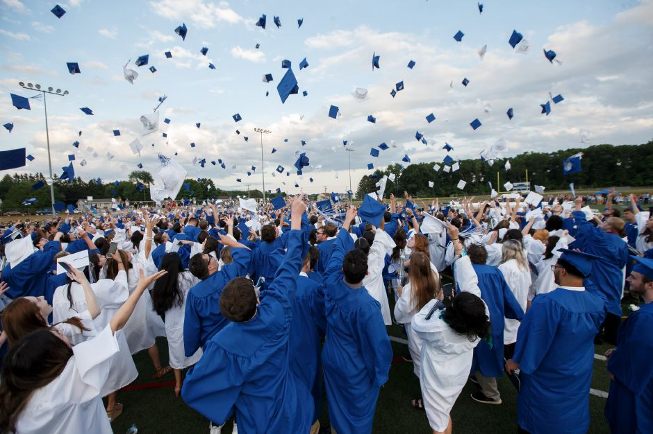 Members of Southington High School's class of 2018 seen tossing their caps into the air during that year's graduation ceremony, in this Record-Journal file photo. Members of the class of 2020 and their families, surveyed by the school district, indicated they would prefer an in-person ceremony that would be held in August, rather than have virtual or drive-thru ceremonies next month.