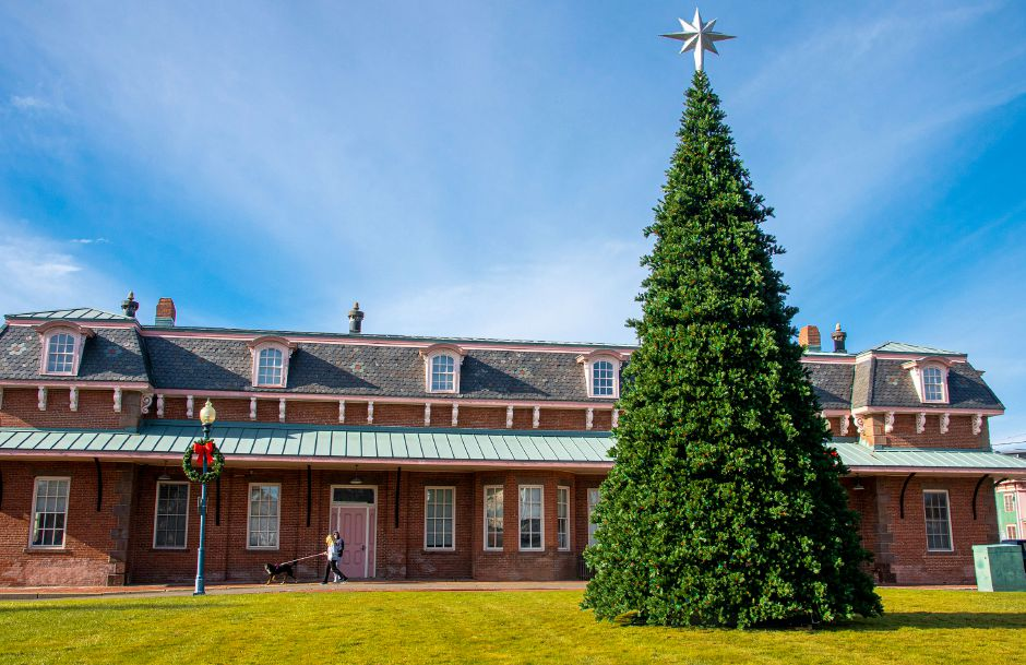 The new outdoor artificial Christmas tree is on display at Johanna Manfreda Fishbein Park between the gazebo and historic train station in downtown Wallingford. Aaron Flaum, Record-Journal