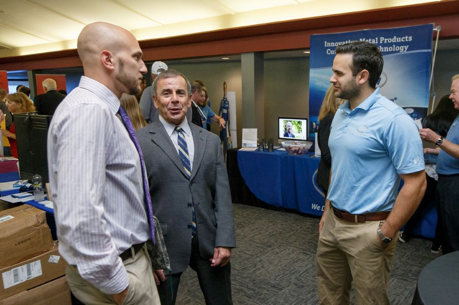 FILE PHOTO – James Thompson left and Mike Freda both of North Haven talk with Wes Ulbrich of Ulbrich Steel Saturday during the 1st Annual Quinnipiac Chamber Manufacturing Job Fair at the Toyota Oakdale Theater in Wallingford September 22, 2018 | Justin Weekes / Special to the Record-Journal
