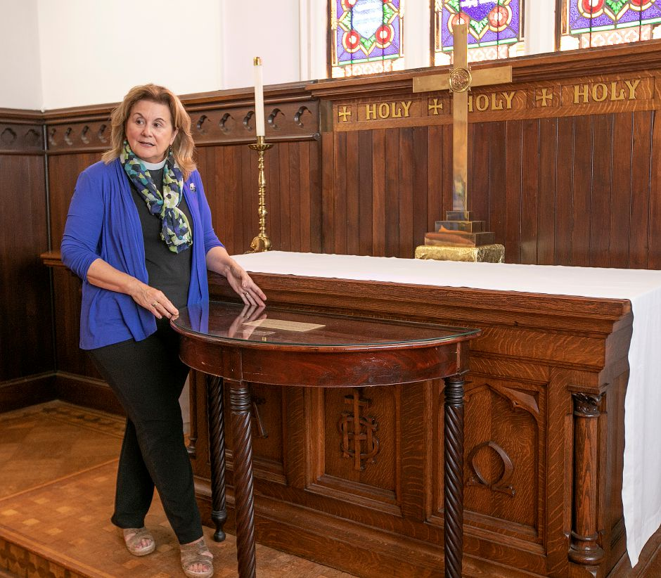 Rev. Dee Anne Dodd shows the original mahogany altar used by St. Paul