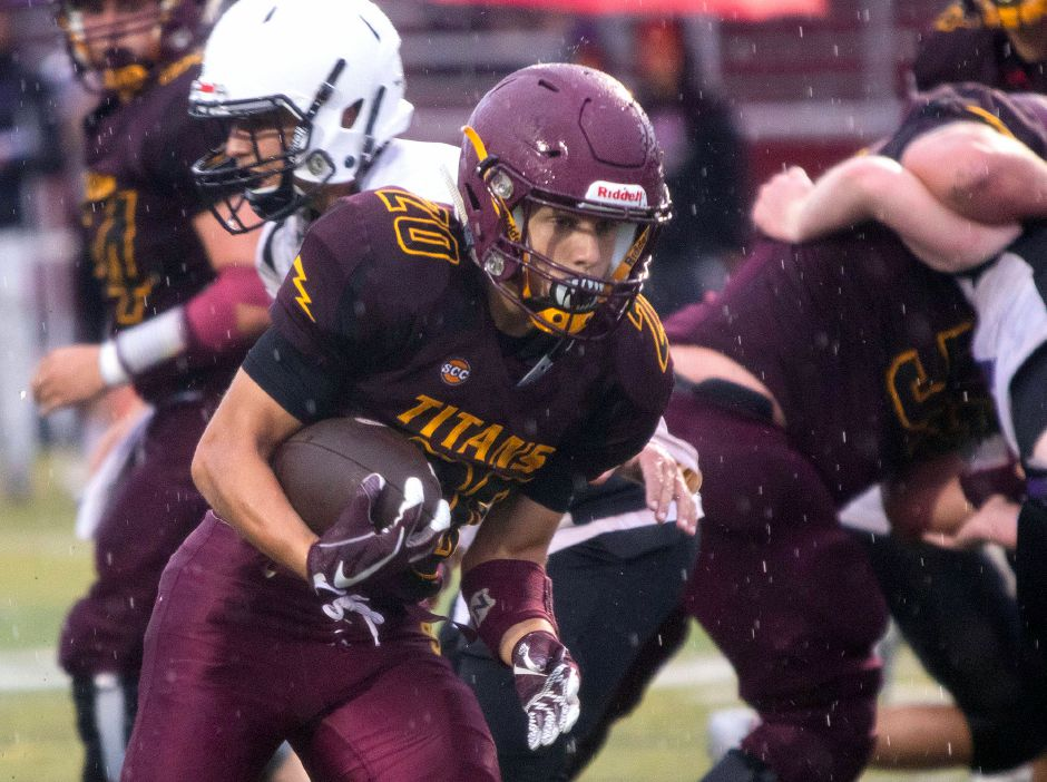 Ryan Villano runs for yardage against North Branford during Friday's scrimmage at Sheehan. Villano, only a sophomore, gives the Titans depth at running back. |  Aaron Flaum, Record-Journal