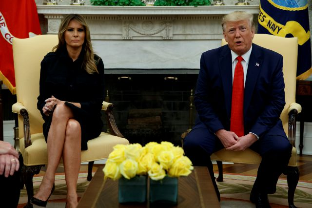 First lady Melania Trump listens as President Donald Trump talks about a plan to ban most flavored e-cigarettes, in the Oval Office of the White House, Wednesday, Sept. 11, 2019, in Washington. (AP Photo/Evan Vucci)