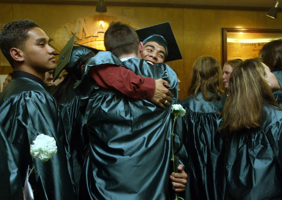 (center facing camera)Jeff Belen and (center with back to camera) Matt Cuccaro clebrate after recieving their diplomas Friday evening after the Francis T. Maloney High School graduation.