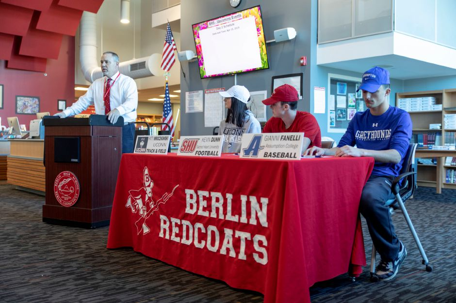 House Speaker and Berlin High School football coach Joe Aresimowicz speaks during a signing day ceremony at Berlin High School on April 4, 2019. Students Patty Mroczkowski, Kevin Dunn and Gianni Fanelli signed letters of intent to play sports at the collegiate level. | Devin Leith-Yessian/Berlin Citizen